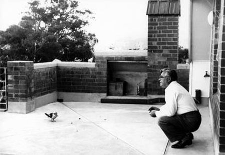 Vladimir Petrov feeding a kookaburra at the ASIO safe house on Sydney's North Shore following his defection. Image courtesy of the National Archives of Australia.