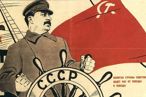 Soviet leader Joseph Stalin at the helm. 1930s Soviet propaganda poster.
